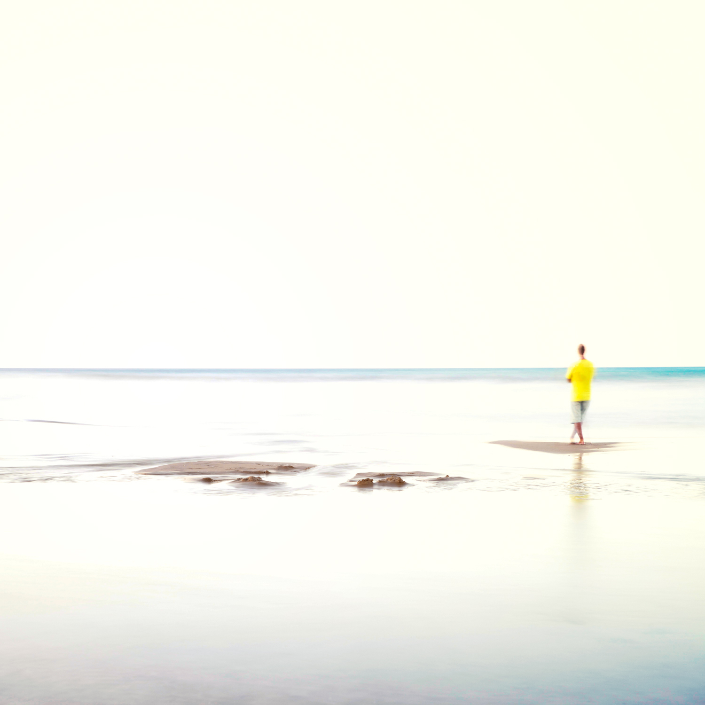 A yellow guy on a white beach