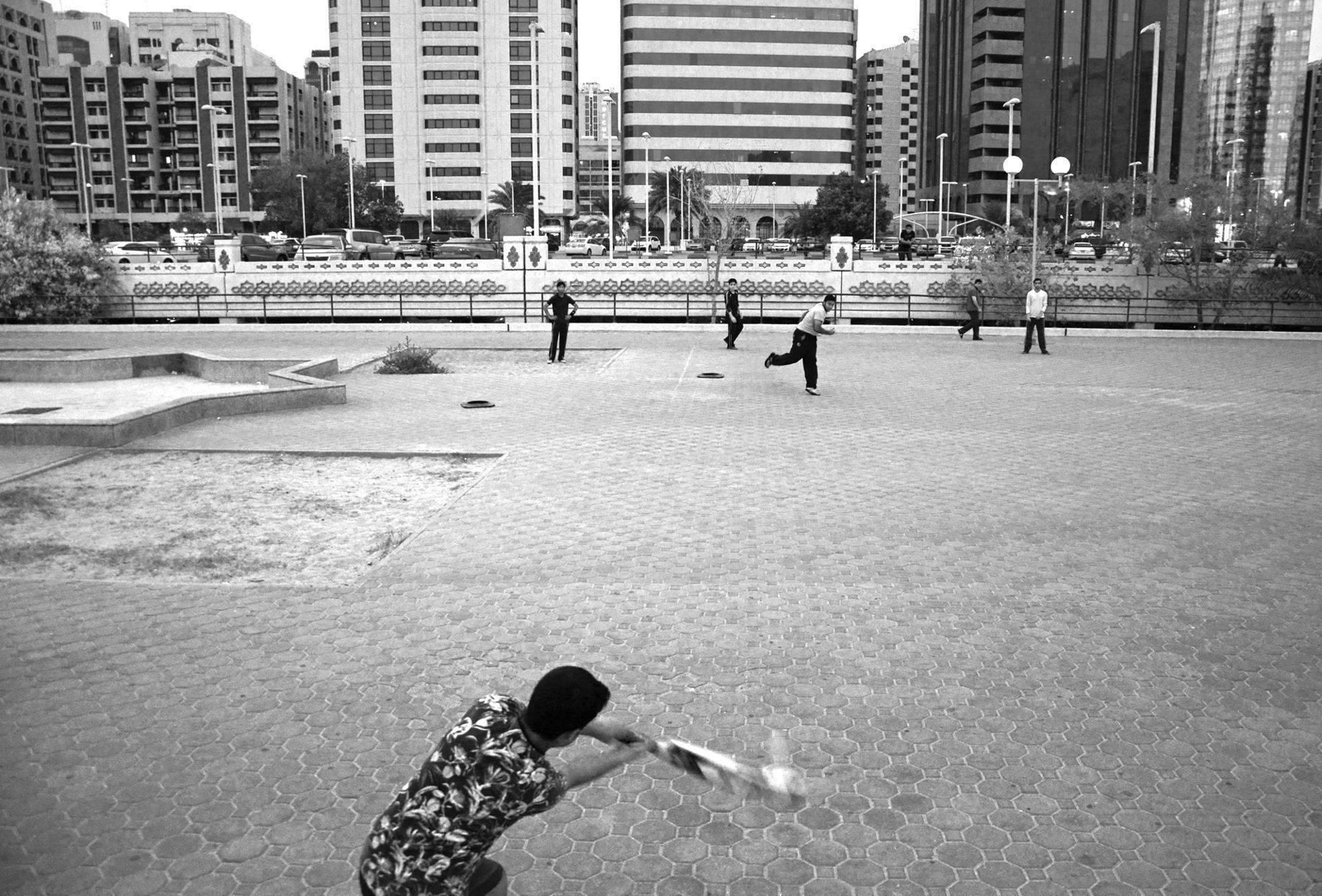 Pakistani workers playing cricket in Abu Dhabi