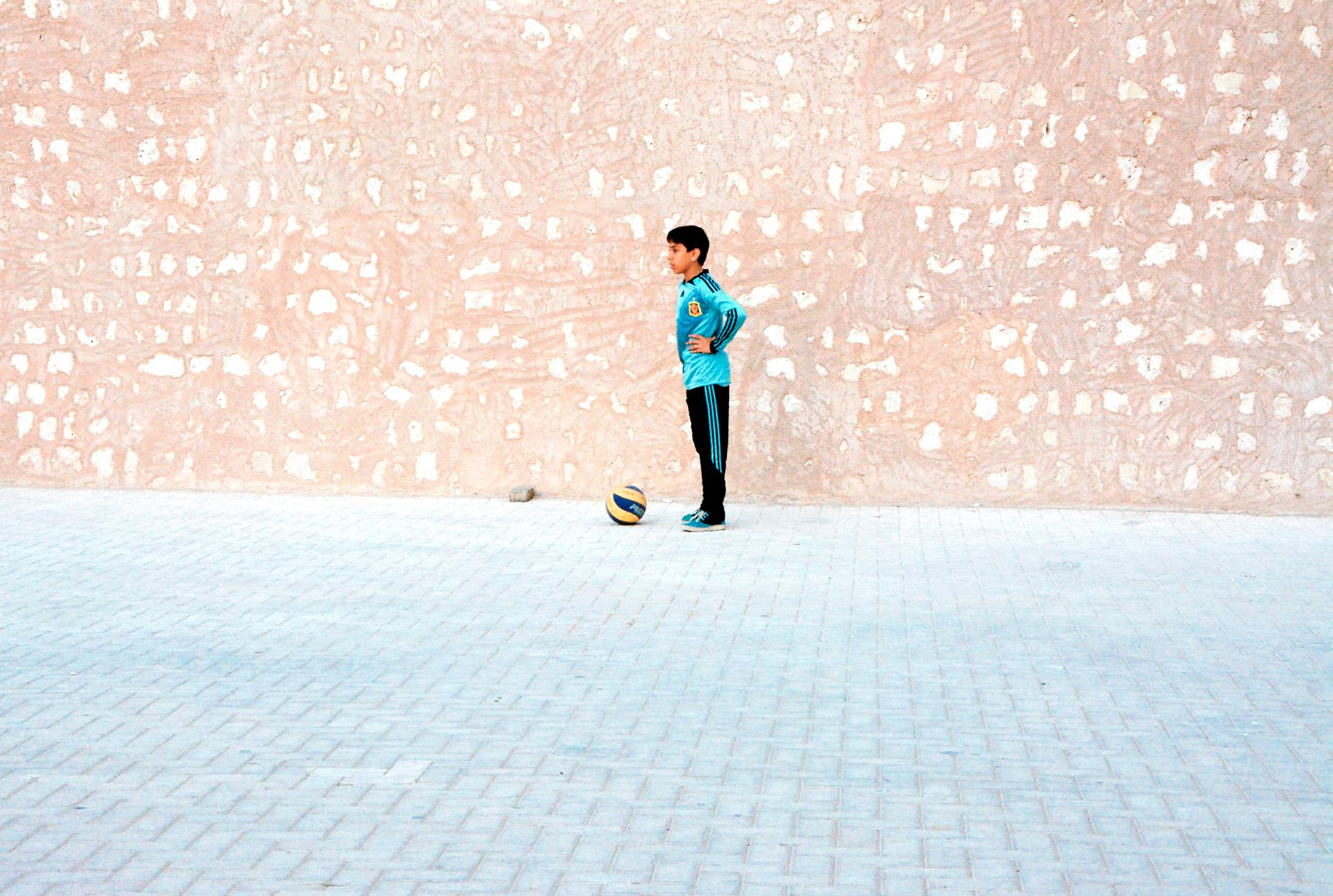 Soccer player in the street, Sharjarh, UAE
