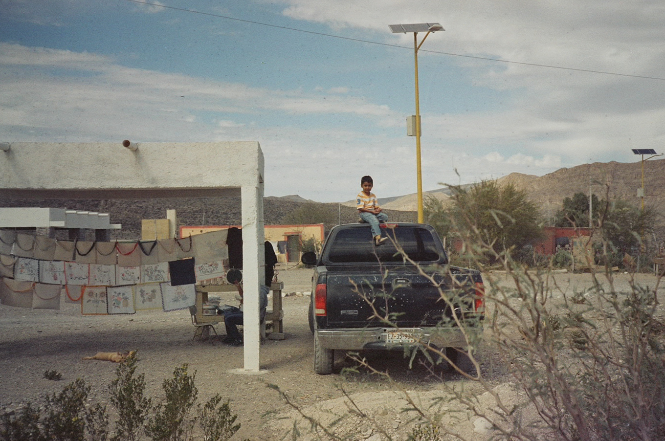 The kid and the car, Boquillas, Mexico, 2017